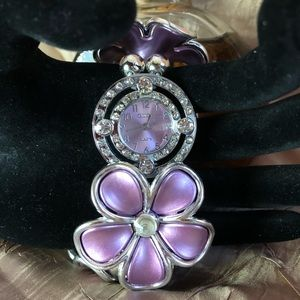 Lilac colored watch with rhinestone. Watch and mad
